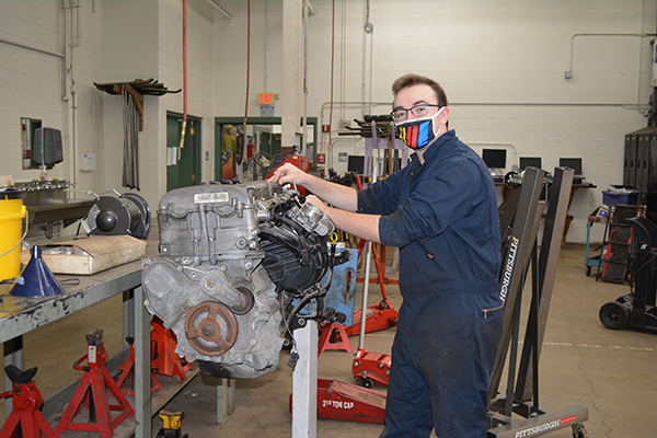 Williamsville's Devyn Waldmiller works on an engine at Harkness.