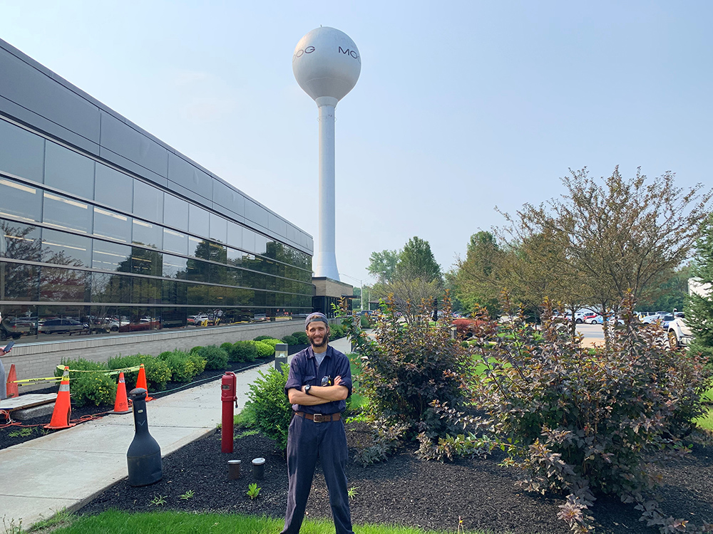 Bill Williams stands in front of the Moog water tower.