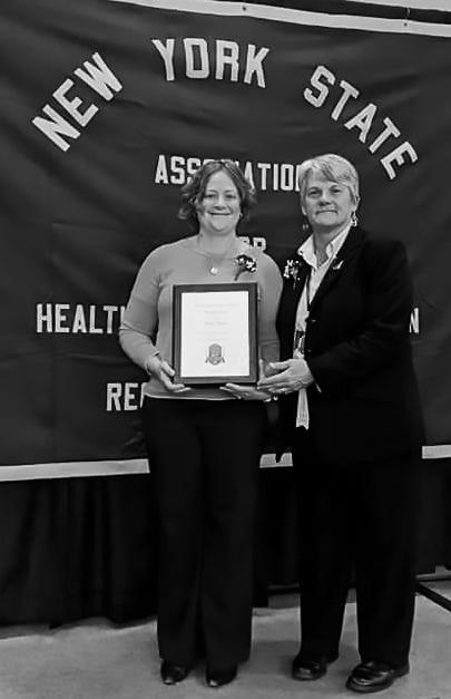 Kate Huber receives award.