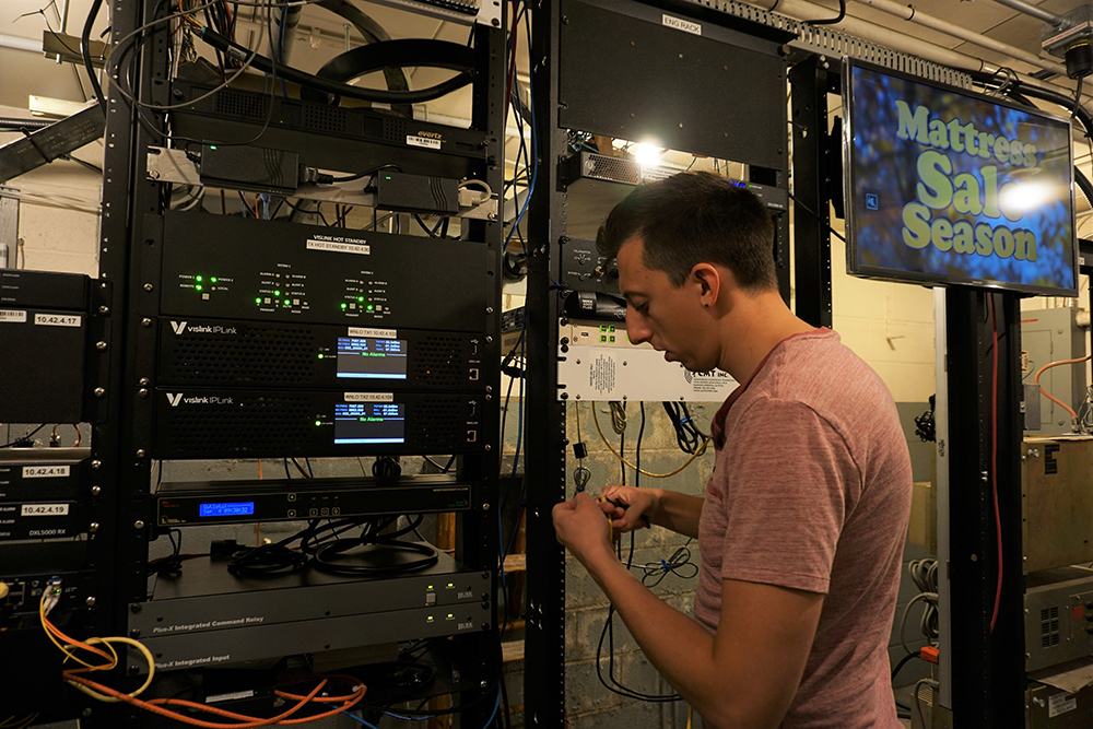 Michael Chmiel at work in the Studio To Transmitter Link building.